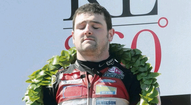 Michael Dunlop celebrates winning the Superstock TT on the Isle of Man