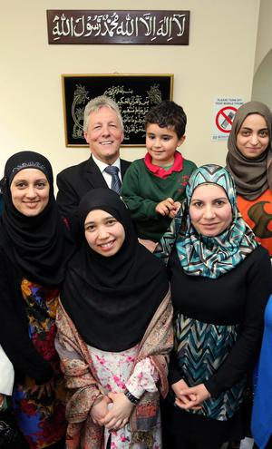 First Minister Peter Robinson with women from the Muslim community at the Belfast Islamic Centre last night