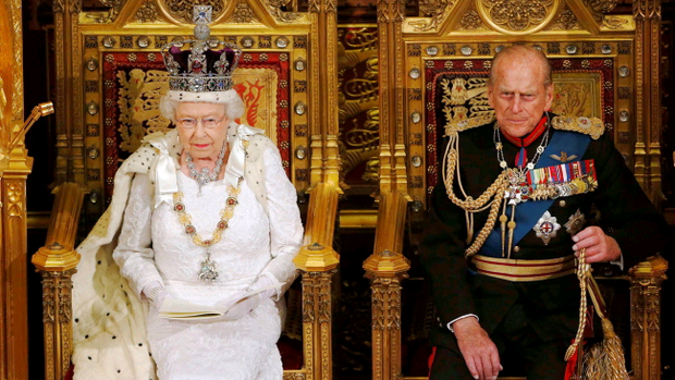 Queen Elizabeth II sits with the Duke of Edinburgh as she delivers her speech.