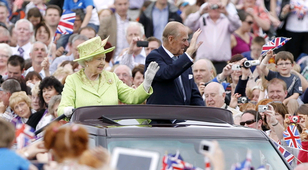 Queen Elizabeth II and the Duke of Edinburgh tour the grounds of Stormont in Belfast, during a two-day visit to Northern Ireland as part of the Diamond Jubilee tour.