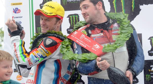 Michael Dunlop (MD Racing Honda) celebrates winning the second Supersport TT on the Isle of Man today with runner up Bruce Anstey PICTURE BY STEPHEN DAVISON