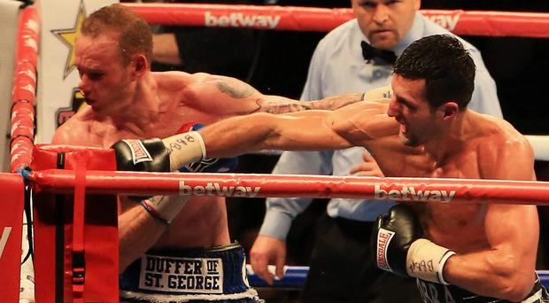 Cobra force: George Groves gets cuffed by Carl Froch. A man hasn't been laid out so low by Cobra since Gandhi's stag do
