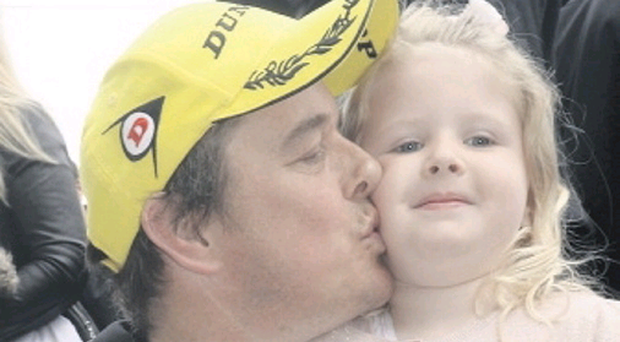 Winning duo: John McGuinness celebrates with his daughter