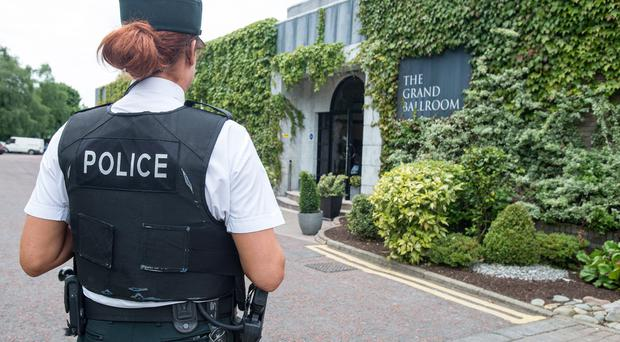 A police officer outside the Everglades Hotel in Derry where a police recruitment information day was held a week after the hotel was firebombed
