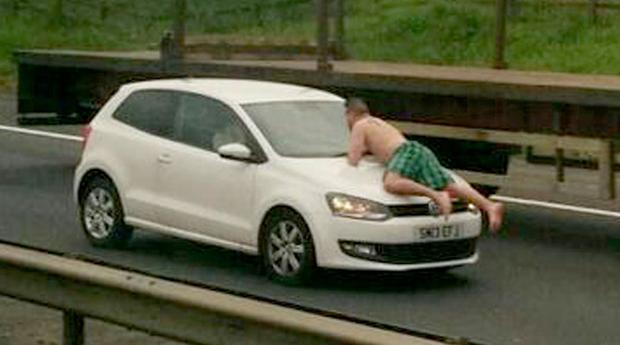 A man caused traffic chaos this morning when he was found wandering along the M8 wearing nothing but green tartan underpants