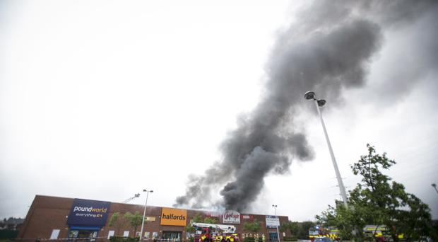 Fire crews tend to a fire which gutted Carpetright at Connswater in East Belfast. Picture Mark McCormick