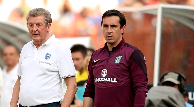 Watching brief: Roy Hodgson and Gary Neville on the touchline in Miami