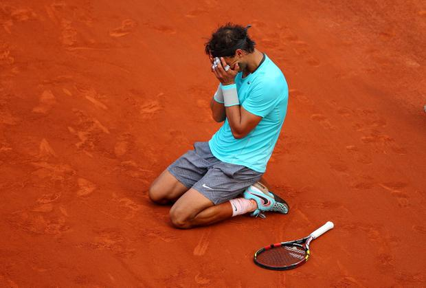 PARIS, FRANCE - JUNE 08: Rafael Nadal of Spain celebrates match point during his men's singles final match against Novak Djokovic of Serbia on day fifteen of the French Open at Roland Garros on June 8, 2014 in Paris, France. (Photo by Clive Brunskill/Getty Images)