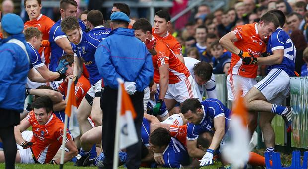 Armagh and Cavan players clash as they line up for the parade during the Ulster Football Championship quarter-final on Sunday June 8 at the Athletic Grounds, Armagh