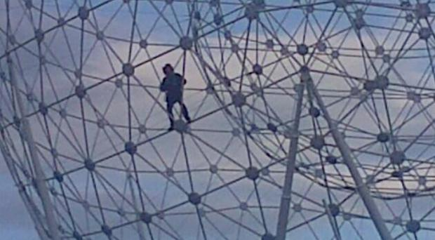 A man climbs up the 40-metre RISE sculpture in west Belfast. Pic Twitter