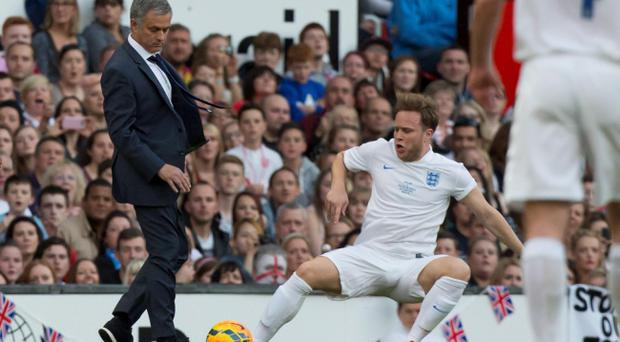 Singer Olly Murs, bottom right, playing for an England team is tripped up by Jose Mourinho