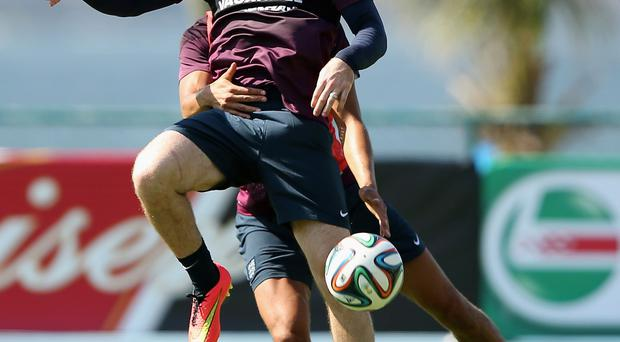 Heat is on: Wayne Rooney in training as England warm up for their opening clash with Italy