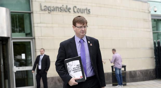 Loyalist campaigner Willie Frazer leaves court after a charge of having a stun gun was withdrawn. Pic Stephen Hamilton/Presseye