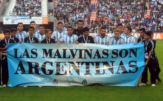 Argentina's team poses for a picture with a banner reading in Spanish