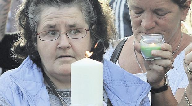 Some of those taking part in a march and candlelit vigil outside the gates of the Dail in Dublin last night