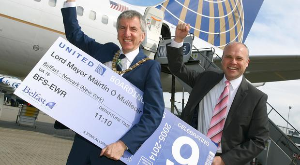 Former Mayor Mairtin O Muilleoir celebrates the ninth anniversary of the United Airlines service with United's Barry Jackson