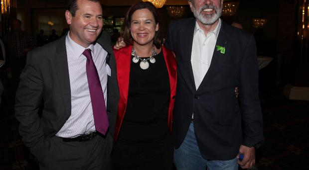Sinn Fein's Paul Donnelly, Mary Lou McDonald and Gerry Adams at the Dublin West by-election count at the Citywest Hotel in Dublin