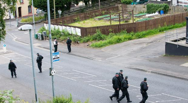 Police at the scene of the bomb alert in Derry. Pic Martin McKeown