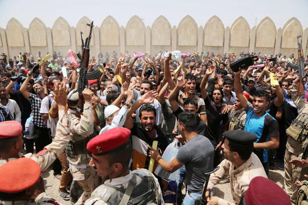 Iraqi men chant slogans against the al-Qaida breakaway group Islamic State of Iraq