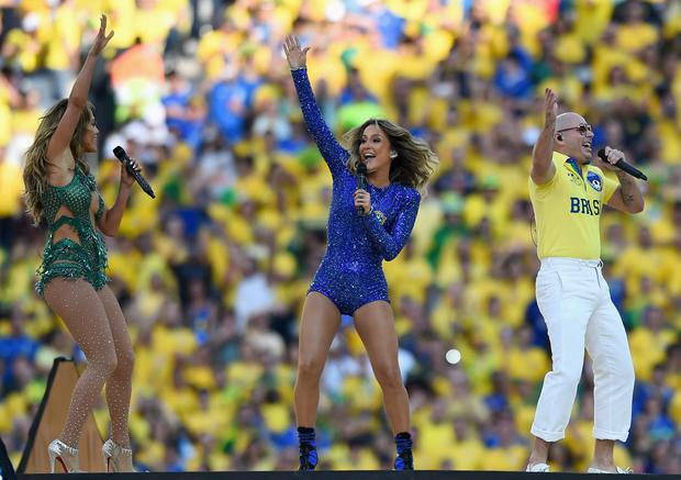 Singers Jennifer Lopez, Claudia Leitte and Pitbull perform during the Opening Ceremony of the 2014 FIFA World Cup Brazil prior to the Group A match between Brazil and Croatia at Arena de Sao Paulo on June 12, 2014 in Sao Paulo, Brazil. (Photo by Buda Mendes/Getty Images)