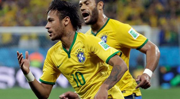 Brazil's Neymar celebrates with Hulk after Neymar scored his sides first goal during the group A World Cup soccer match between Brazil and Croatia, the opening game of the tournament, in the Itaquerao Stadium in Sao Paulo, Brazil, Thursday, June 12, 2014. (AP Photo/Felipe Dana)