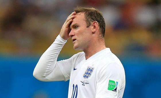 A dejected Wayne Rooney during the World Cup in Brazil