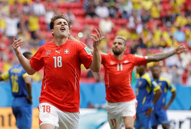 Switzerland's Admir Mehmedi celebrates after scoring his side's first goal during the group E World Cup soccer match between Switzerland and Ecuador at the Estadio Nacional in Brasilia, Brazil, Sunday, June 15, 2014. (AP Photo/Michael Sohn)