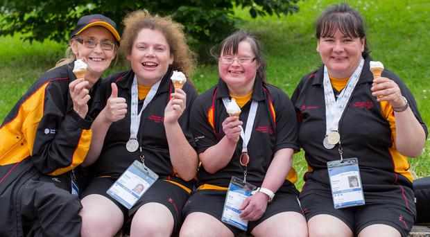 Winners: Team Ulster athletes Kathleen McLoone, Cherie Doherty, Brid Thomas and Tracey Murphy enjoy an ice cream yesterday after medal-winning performances at the Special Olympics in Limerick