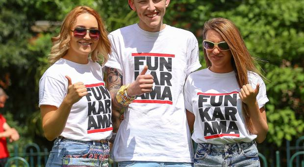 Chantelle McKenna, Curtis Sanders and Seaneen Fleming enjoy the good weather at Botanic Gardens in Belfast. Photo: Kevin Scott / Presseye