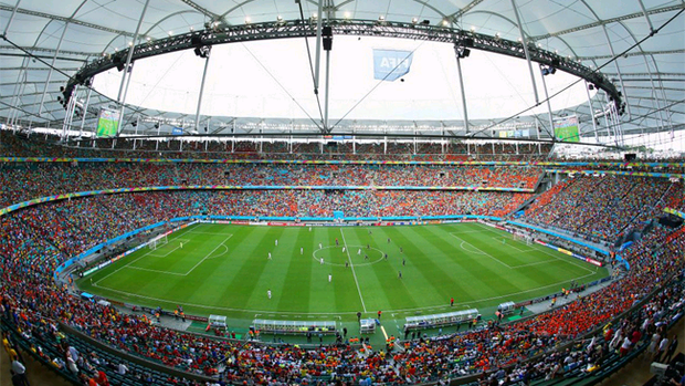 Numerous pockets of empty blue seats stand out during the game between Spain and the Netherland
