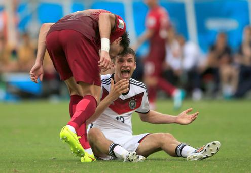 Portugal's Pepe headbutts Germany's Thomas Muller