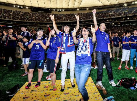 Japanese fans celebrate a goal during the 2014 FIFA World Cup match between Japan and Ivory Coast