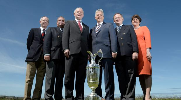 Peter Unsworth (Chairman of The R&A Championship Committee), Peter Dawson (R&A Chief Executive), Simon Rankin Captain, Royal Portrush Golf Club, First Minister the Rt. Hon. Peter D Robinson MLA, Deputy First Minister Martin McGuinness MLA, Enterprise, Trade and Investment Minister, Arlene Foster with the Open Championship trophy at Royal Portrush Golf Club on June 16, 2014 in Portrush, Northern Ireland