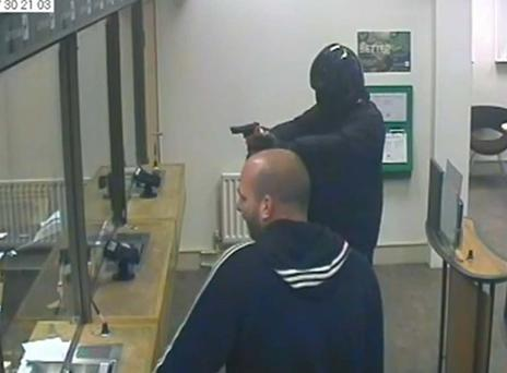 The moment a have-a-go stops armed robbery in bank after noticing gun is fake before chasing him down the street