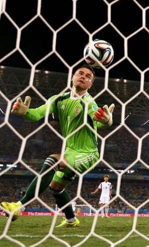 Igor Akinfeev of Russia fails to save a shot by Lee Keun-Ho of South Korea (Photo by Warren Little/Getty Images)