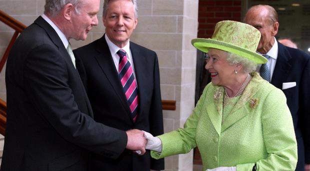 Martin McGuinness shakes hands with the Queen at the Lyric in Belfast in 2012