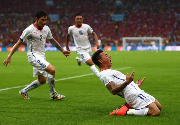 Eduardo Vargas of Chile celebrates scoring his team's first goal with against Spain