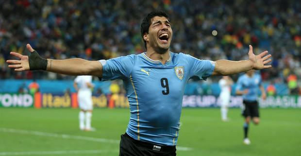 Uruguay's Luis Suarez celebrates scoring his side's second goal during the Group D match the Estadio do Sao Paulo, Sao Paulo, Brazil.