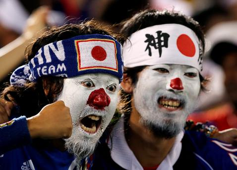 Japanese fans cheer for their national team before the start of the group C World Cup soccer match between Japan and Greece at the Arena das Dunas in Natal, Brazil, Thursday, June 19, 2014. (AP Photo/Petr David Josek)
