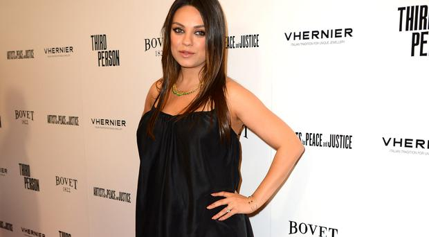 Mila Kunis arrives at Los Angeles premiere of Third Person