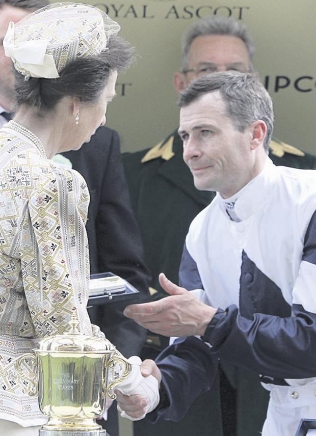 Royal occasion: Pat Smullen is in action at Down Royal today after a Royal Ascot double, here receiving a trophy from The Princess Royal after Anthem Alexander's win in the Queen Mary Stakes