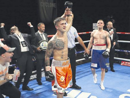 Winning feeling: Marc McCullough's hand is raised as he is confirmed as the new WBO European featherweight champion