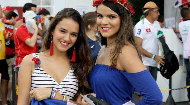 The beautiful game - football fans from around the world - Fans arrive for the Group E match between Switzerland and France during the 2014 FIFA World Cup Brazil at Arena Fonte Nova on June 20, 2014 in Salvador, Bahia, Brazil. (Photo by Felipe Oliveira / Getty Images)