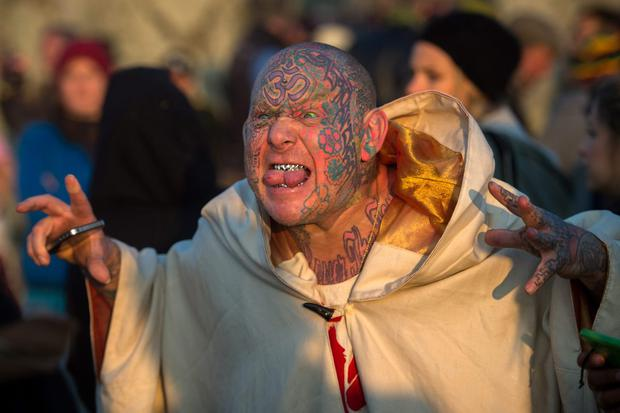 Mad Al takes part in the summer solstice dawn celebrations after druids, pagans and revellers gathered for the Summer Solstice sunrise at Stonehenge on June 21, 2014 in Wiltshire, England. (Photo by Tim Ireland/Getty Images)