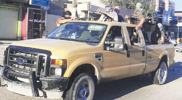 Militants from the Islamic State of Iraq and the Levant patrol in Fallujah