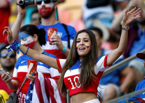 A Portugal supporter dances in the stands before the group G World Cup soccer match between the United States and Portugal at the Arena da Amazonia in Manaus, Brazil, Sunday, June 22, 2014. (AP Photo/Julio Cortez)