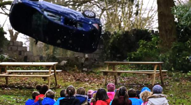 The latest shocking DOE road safety video shows a speeding car killing entire group of children