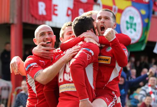 Cliftonville's Joe Gormley celebrates with Martin Donnelly and Barry Johnston after winning the Irish League in April