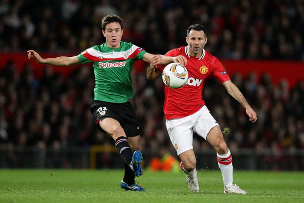 File photo dated 08/03/12 of Manchester United's Ryan Giggs and Athletic Bilbao's Aguera Ander Herrera (left) battle for the ball