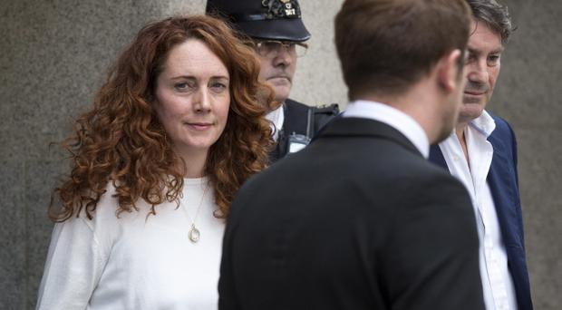 Former News International chief executive Rebekah Brooks and her husband Charlie Brooks leave the Old Bailey on June 24, 2014 in London, England. (Photo by Rob Stothard/Getty Images)
